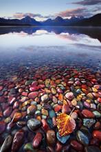 View Of Multicolored Rocks In McDonald Lake