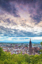 Scenic View Of Freiburg City Against Cloudy Sky