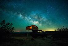 View Of Car And Tent At Camping Site Under Milky Way