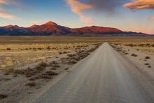 View Of Road Passing Through Desert Landscape