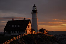 View Of Lighthouse During Sunrise