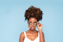Afro Woman Wearing Sunglasses And Earrings.