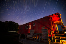 Star Trails Over Grassy Creek Cabooses At Night