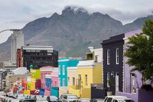 View Of Colorful Houses With Mountain In Background