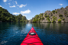 Kayak Boat In Coron Island With Trees And Mountain In Background