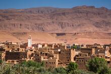 View Of Village Against Mountain In Desert