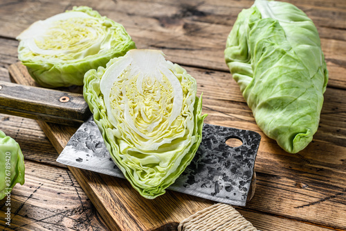 Raw Cutting Pointed white cabbage head on a cutting board Fototapete