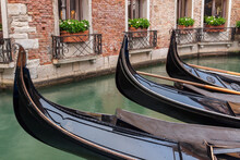 Gondola Boats Moored In Canal