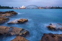 Scenic View Of Sydney Opera House And Sydney Harbour Bridge At Dusk