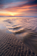 Scenic View Of San Gregorio Creek Flowing Along Beach During Sunset
