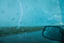 View Of Lightning Seen Through Car Window