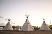 View Of Teepee Tents Against Sky