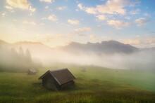View Of Cabin On Grassy Landsc...