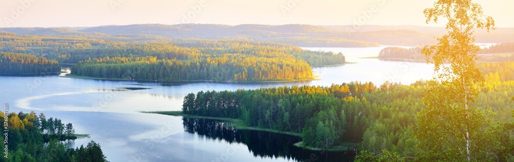 Fototapeta Clear blue Saimaa lake at sunset, Finland, aerial view. Picturesque panoramic scenery. Atmospheric landscape. Pure nature, ecology, environmental conservation, eco tourism, travel destinations
