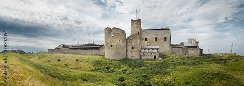 Picturesque panoramic view of the walls and towers of Rakvere castle on the green hills, Estonia Wallpaper Mural
