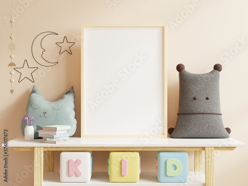Mock up posters in child room interior, posters on empty cream color wall background.