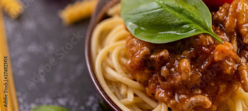 Spaghetti saute in a gray plate with tomatoes and basil Wallpaper Mural