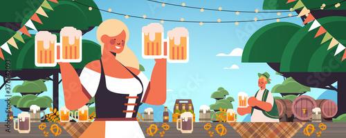 Fototapeta girl waitress holding beer mugs Oktoberfest party celebration concept woman in german traditional clothes having fun portrait horizontal vector illustration obraz