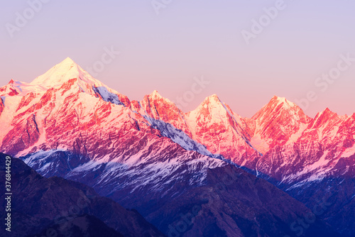 Panoramic view during sunset over snow cladded Panchchuli peaks falls in great Himalayan mountain range from small hamlet Munsiyari, Kumaon region, Uttarakhand, India Canvas Print