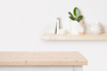 Natural Wooden Table Top And Blurred Wall With Kitchen Shelf