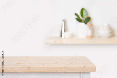Fényképezés Natural wooden table top and blurred wall with kitchen shelf