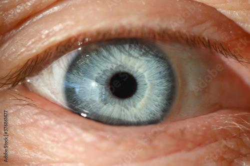 Blue human eye with black pupil closeup Fotobehang
