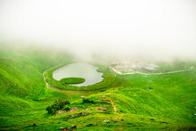 View At Prashar Lake Located At A Height Of 2730 M Above Sea Level With A Three Storied Pagoda-like Temple Of Sage Prashar Near Mandi, Himachal Pradesh, India. The Lake Has A Floating Island In It