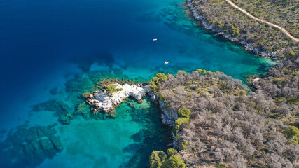 Aerial drone photo of famous from Mamma Mia movie Three pine cape Amarantos a trully scenic place with crystal clear sea, Skopelos island, Sporades, Greece