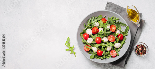Diet and healthy salad with arugula, cherry tomatoes, mozzarella cheese and oliv Fotobehang