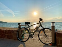 A Bike Leaning Against The Wall By The Beach