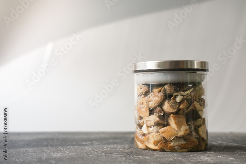 Papel de parede homemade canned pickled forest mushrooms on a grey table