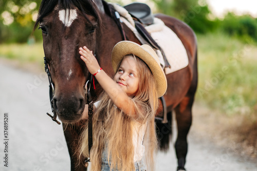 Fotografie, Obraz Friendship of a child with a horse