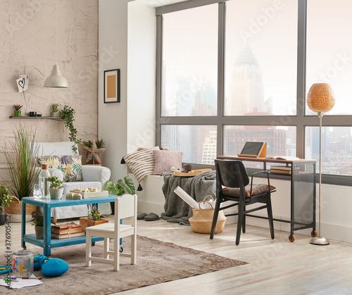 Fototapeta Modern decorative living room corner and city view, child object interior style. Work table and laptop. obraz na płótnie