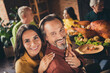 canvas print picture - Closeup photo of full family gathering bearded husband wife cuddle beaming smiling hold hands finish eat meal sit served dinner big table turkey generation in evening living room indoors