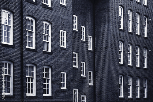 Fototapeta Old brick building with windows