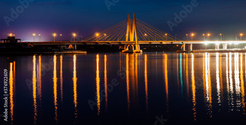 Fototapeta Millenium bridge in Kazan, reflected in the waters of the river Kazanka. Cable-stayed bridge across the river. The bridge with night lighting. obraz na płótnie