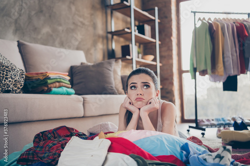 Obraz Photo of pretty stressed crying lady stay home quarantine lying many clothes heap stack floor wardrobe stuff pick select date look outfit nothing to wear concept living room indoors - fototapety do salonu