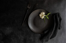 White Rose On A Black Place Setting
