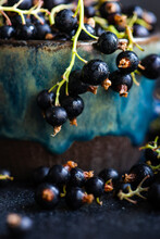 Close-up Of A Cup Of Fresh Blackcurrants