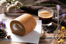 Slice Coffee Roll Cake On Whit...