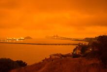 Richmond - San Rafael Bridge In Orange Smoke And Fog From Northern California Wildfires