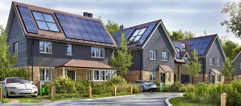 Fototapeta Street of beautiful residential houses with rooftop solar panels and electric cars
