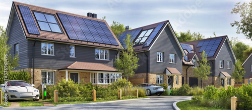 Fototapeta Street of beautiful residential houses with rooftop solar panels and electric cars obraz