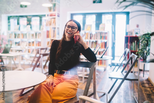 Fotografering Happy Caucasian woman in classic glasses for provide eyes protection laughing du