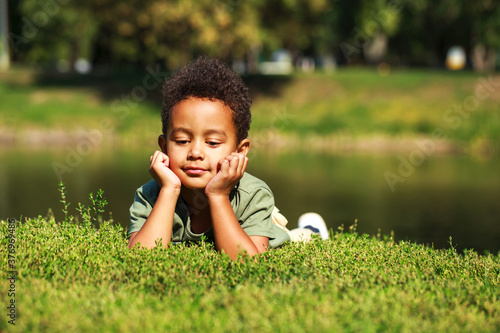 Portrait of little boy in autumn park Canvas-taulu