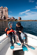 A Mom And Her Son Getting Ready To Snorkel At Espíritu Santo Island.