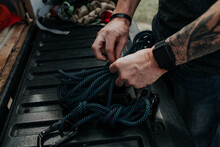 Close Up Of Man Prepping Climbing Ropes