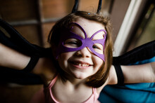 Close Up Of Young Girl In Dress Up Smiling For Camera