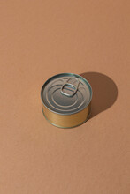 Single Tin Can With Preserved Food Placed On Brown Surface