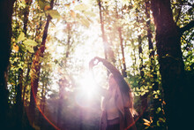 Pretty Girl Poses In Nature Makes Heart With Hands